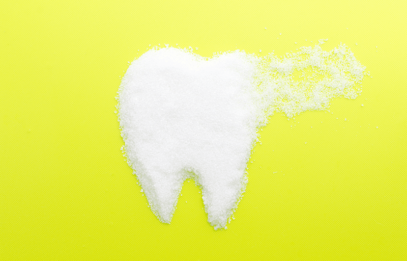 white tooth with yellow backgrounf