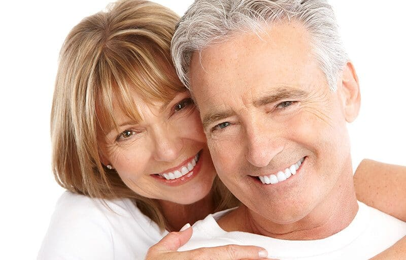 Smiling couple with implants